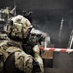 Operator of JW Formoza during the CQB exercise, wearing Ops-Core® FAST Covers in MultiCam®.